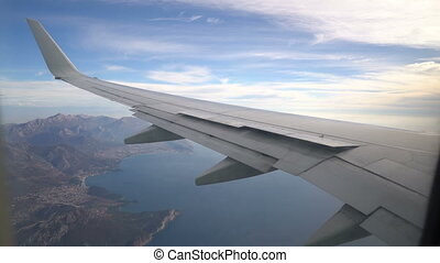view from the aircraft to the mountains