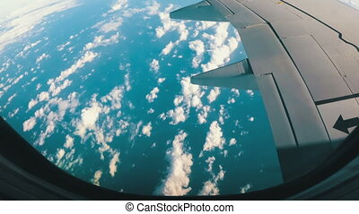 View from the Airplane Window on a Landscape of Clouds