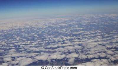 View from the airplane window on the clouds departure from...