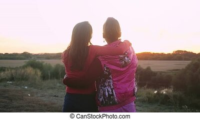 View from the back of mum and daughter watching the sunset...