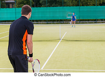 View from the back on a male tennis player
