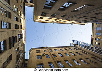 View from the bottom up in court yard-wells in the historic...