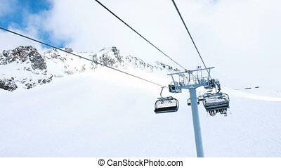 View from the chairlift in motion to the top, four-seat...
