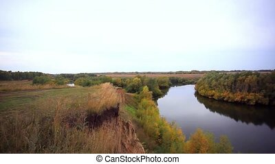 view from the cliff on Autumn forest and river in the fall season.