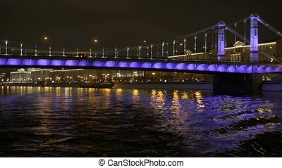 View from the deck of a ship that swims across the river at night in Moscow.
