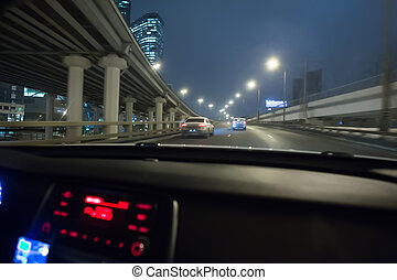 view from the driving car on night traffic