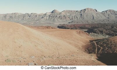 View from the drone - volcanic sand hills, desert and high mountains in the Teide National Park, Tenerife, Canary Islands, Spain