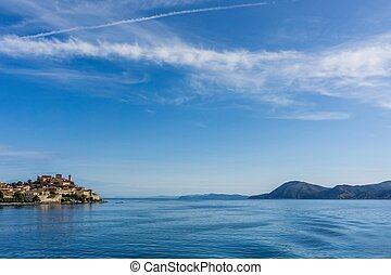 View from the ferry on part of Portoferraio and rock on another side of Elba