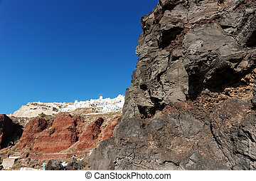View from the harbor on Oia, a beautiful village on the volcanic island of Santorini