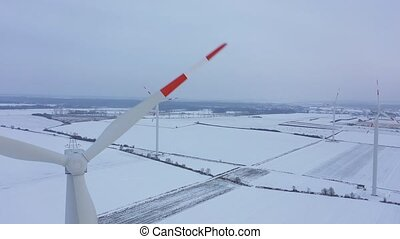 View from the height of energy producing wind turbines in...