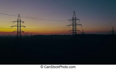 View from the height of power line silhouettes against...