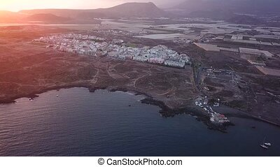 View from the height of the city on the Atlantic coast at sunset. Tenerife, Canary Islands, Spain