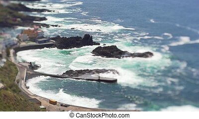 View from the height of the ocean and a small Spanish...