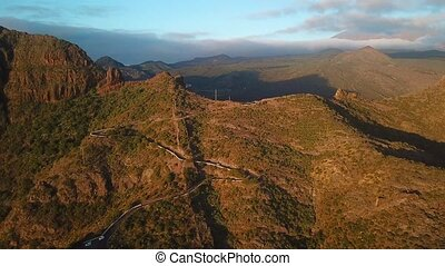 View from the height of the rocks and winding road in the Masca at sunset, Tenerife, Canary Islands, Spain.