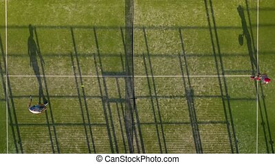 View from the height of the tennis court where people play...