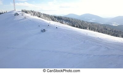 View from the height on people driving snowmobile on...