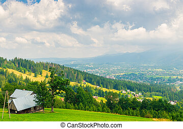 view from the heights of a beautiful house in the valley of the mountains in Poland