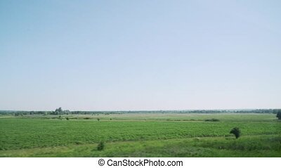 View from the high speed train at beautiful landscapes with hills and forest. ukraine
