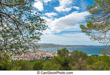 View from the hills into St Antoni de Portmany & surrounding area in Ibiza.  Clearing November day in the bay.  Islands near Spain.