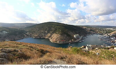 View from the mountain to Balaklava Bay on a sunset, the Crimea, panning