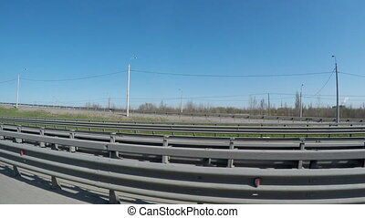 View from the moving car on the modern speedway with portly...