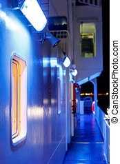 view from the outside on the ferry, porthole and blue illumination at night