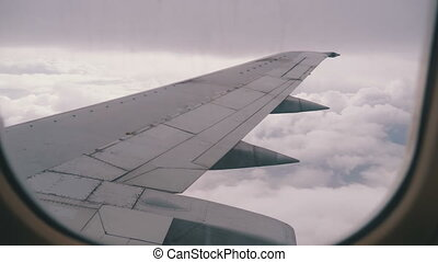View from the Passenger Airplane Window on the Wing Flying...