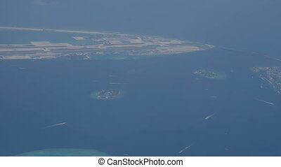 View from the plane to the beach of a tropical island with...