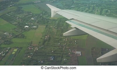 View from the plane to wing of the plane and cumulus clouds over Bagkok stock footage video