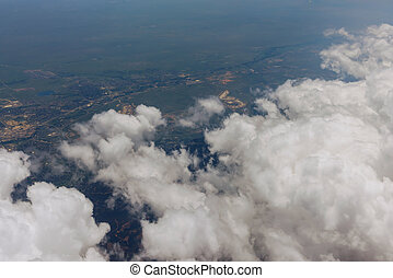 View from the plane window overlooking the clouds and the structure of Denver city in America