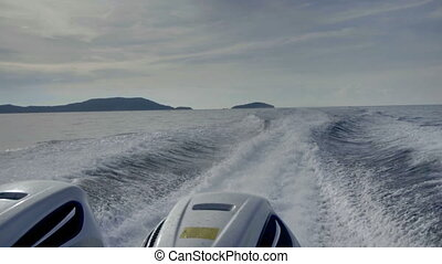 View from the rear of moving speedboat, slow motion, HDR...