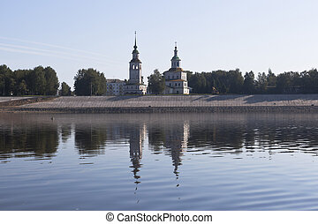 View from the river Sukhona on a church of St. Nicholas in the city of Veliky Ustyug on a summer morning