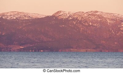 View from the sea on a long mountain along the shore. Trondheim fjord, Norway. Panning from left to right.