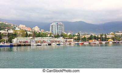 View from the sea on the embankment in Yalta, the Crimea