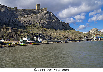 View from the sea to the ancient Genoese fortress.