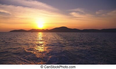 view from the sea to the island during sunset, seascape.