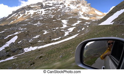 view from the side window of the car while driving along the...