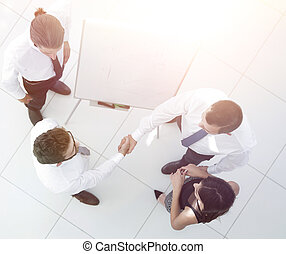 view from the top. background image of handshake of business partners