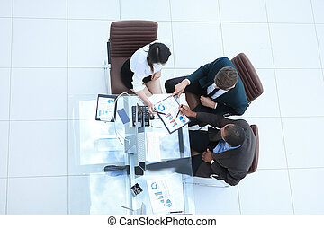 view from the top. business team making a financial report.