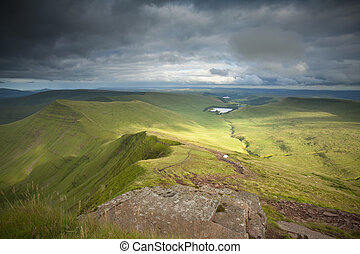 View from the top of Pen-y-Fan in the Brecon Beacons looking towards Talybont reservoir and Cribyn, Powys, Wales