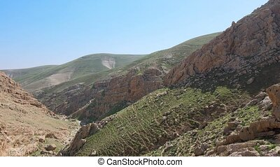 View of the Judean desert in Israel and the West Bank that lies east of Jerusalem and descends to the Dead Sea. At the mouth of the river Jordan, John the Baptist baptized people and Jesus