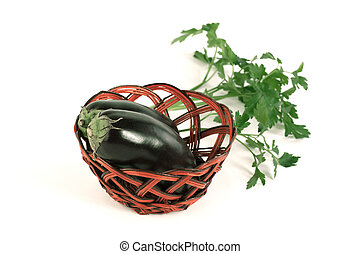 view from the top. two ripe eggplant in a wicker basket. isolated