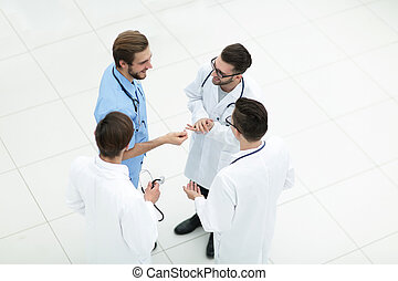 smiling group of doctors discussing