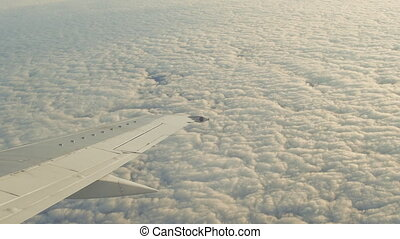 View from the window of a flying airplane