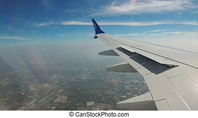 View from the Window of a Jet Plane on the Bangkok City Landscape