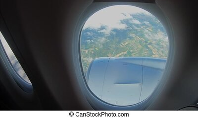 View from the window of a passenger airplane of a landscape. Airplane window view.