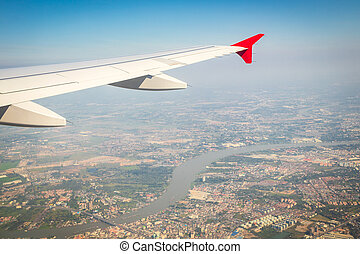 View from the window of airplane on the outskirts of bangkok city