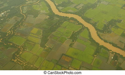 View from the window of an airplane on the Mekong River....