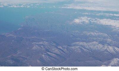 View from the window of plane flying over Krasnodar Krai stock footage video
