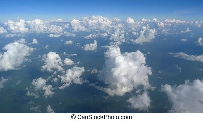 View from the window of the aircraft to the clouds
